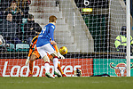 The ball hits David Bates and Hibs claim for a penalty