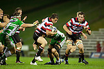 Mark Selwyn pushes his way out of Hamish Gosling's tackle. ITM Cup rugby game between Counties Manukau and Manawatu played at Bayer Growers Stadium on Saturday August 21st 2010..Counties Manukau won 35 - 14 after leading 14 - 7 at halftime.