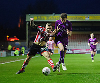 Lincoln City's Harry Anderson vies for possession with Carlisle United's Macaulay Gillesphey<br /> <br /> Photographer Chris Vaughan/CameraSport<br /> <br /> The Emirates FA Cup Second Round - Lincoln City v Carlisle United - Saturday 1st December 2018 - Sincil Bank - Lincoln<br />  <br /> World Copyright © 2018 CameraSport. All rights reserved. 43 Linden Ave. Countesthorpe. Leicester. England. LE8 5PG - Tel: +44 (0) 116 277 4147 - admin@camerasport.com - www.camerasport.com