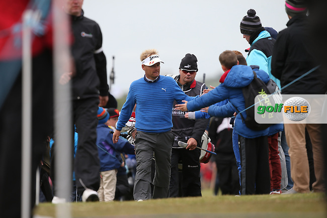 High fives for Soren Kjeldsen (DEN) heading to the 18th during Round Three of the 2015 Dubai Duty Free Irish Open Hosted by The Rory Foundation at Royal County Down Golf Club, Newcastle County Down, Northern Ireland. 30/05/2015. Picture David Lloyd | www.golffile.ie