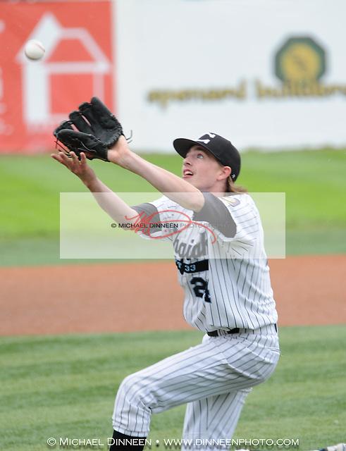 Starting pitcher Cody Curfman fields an infileld pop up.