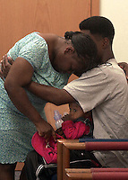 .4-27-00,1A.Bertha Bradley mother of Timothy Hurst is consoled outside the courtroom after Circuit Judge Joseph Q. Tarbuck sentanced her son to death for the murder of Cynthia Harrison a Popeye's restraunt assistant manager in May 1998..\fp\\b0\\i0\\fs10\--------------------------------.\fp\\i0\\b\\fs16\Copyright 2000 Pensacola News Journal..\fp\\b0\\i0\\fs10\Copyright=Yes; Year=2000; Month=4; Month=Apr; Day=26; Day=We; Photographer=Michael_Spooneybarger; Person=Bertha_Bradley; Mainkey=Crime/Homicide/Murder; Subkey=Courts/Sentence; ..Aspect=Local:Staff; Aspect=26.04.2000; Aspect=Color; Aspect=Yes; Aspect=2000; Aspect=4; Aspect=Apr; Aspect=26; Aspect=We; Aspect=Michael_Spooneybarger; Aspect=Bertha_Bradley; Aspect=Crime; Aspect=Homicide; Aspect=Murder; Aspect=Courts; Aspect=Sentence;