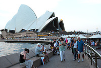 The environs of Sydney Opera House is a popular meeting place for a drink with friends & relaxation especially in the early evening when it is still warm enough to be in short sleeves. 201003284933..Copyright Image from Victor Patterson, 54 Dorchester Park, Belfast, United Kingdom, UK. Tel: +44 28 90661296. Email: victorpatterson@me.com; Back-up: victorpatterson@gmail.com..For my Terms and Conditions of Use go to www.victorpatterson.com and click on the appropriate tab.