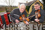 MUSIC MAKERS: Paddy O'Sullivan and Peter Mullarky strike up a tune outside the old Cashlaugh National School in Dromid as they prepare for the Dromid Heritage Society Easter Week celebrations.