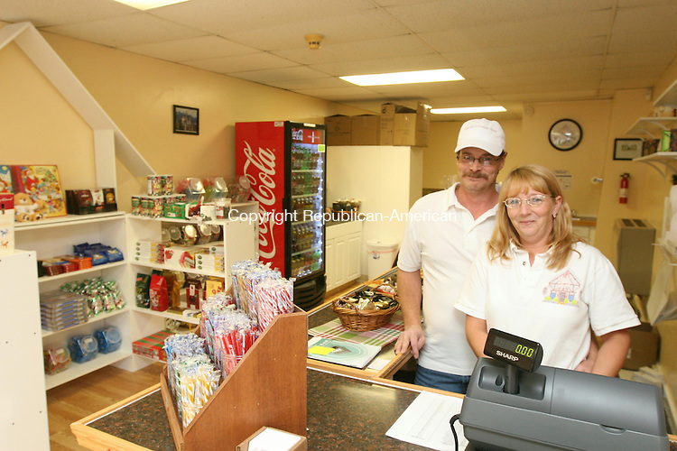 WINSTED, CT - 6 November, 2010 - 110610MO06 - Frank and Sandy Follett opened a candy shop, Sandy's Candy Haus, at 450 Main St. in Winsted Saturday. This is the couple's first foray into retail, and an addition to the Main Street lineup welcomed by local officials.  Jim Moore Republican-American.