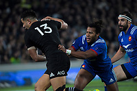 France's Teddy Thomas tries to tackle NZ's Anton Lienert-Brown during the Steinlager Series international rugby match between the New Zealand All Blacks and France at Eden Park in Auckland, New Zealand on Saturday, 9 June 2018. Photo: Dave Lintott / lintottphoto.co.nz