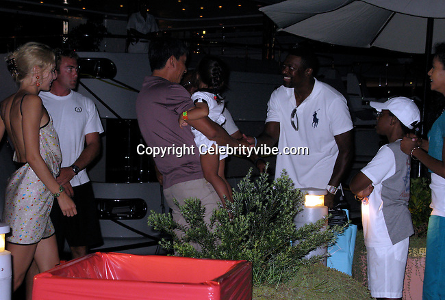 **EXCLUSIVE**.Chris Tucker with wife, Benissima, and son Destin Christopher Tucker..Chris Tucker with wife and son went shopping, eat ice cream and meet with an unidentified friend who pulled up into Porto Cervo Marina with a Mega Yacht named Apogee, which it is owned by Darwin Deason..They waited for twenty minutes in front of a barricade with everyone else till the Yacht was parked, and then they went on board..Porto Cervo, Sardinia, Italy..Sunday, August 09, 2009..Photo By Celebrityvibe.com.To license this image please call (212) 410 5354; or Email: celebrityvibe@gmail.com ; .website: www.celebrityvibe.com.