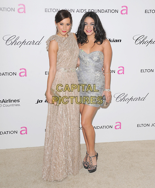 ASHLEY TISDALE & VANESSA HUDGENS.19th Annual Elton John AIDS Foundation Academy Awards Viewing Party held at The Pacific Design Center, West Hollywood, California, USA..February 27th, 2011.full length beige maxi sleeveless dress silver strapless dress clutch bag.CAP/RKE/DVS.©DVS/RockinExposures/Capital Pictures.