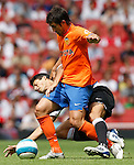 Inter Milan's Julio Cruz tackled by Valencia's David Silva.Pic SPORTIMAGE/Simon Bellis..Pre-Season Friendly..Internazionale v Valencia..28th July, 2007..--------------------..Sportimage +44 7980659747..admin@sportimage.co.uk..http://www.sportimage.co.uk/