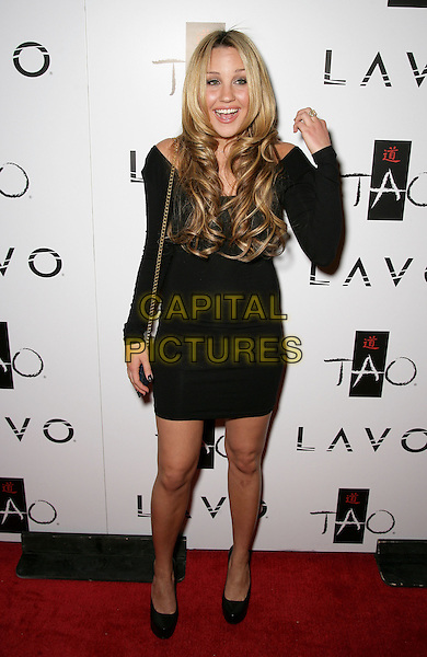 AMANDA BYNES .Tao Asian Bistro and Nightclub Celebrates its 4th Anniversary at the Venetian Resort Hotel and Casino, Las Vegas, Nevada, USA, 3rd October 2009..full length black dress long sleeved sleeves hand mouth open funny shoes chain strap shoulder bag bad posture hunched .CAP/ADM/MJT.©MJT/Admedia/Capital Pictures