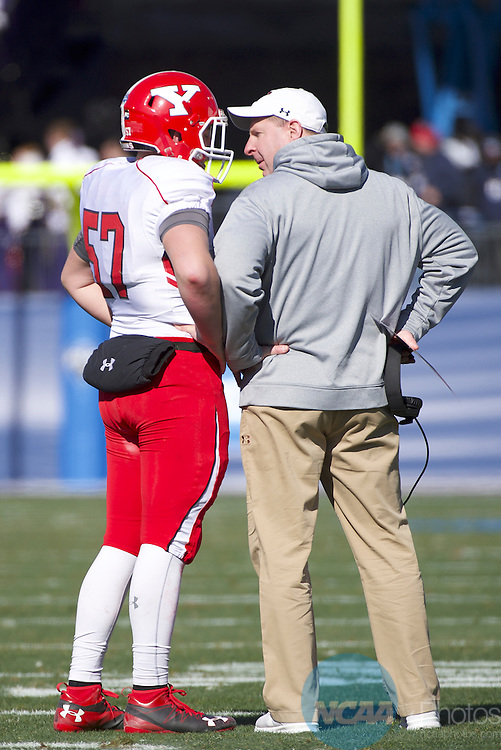 FRISCO, TX - JANUARY 07:  Head Coach Bo Pelini of Youngstown State University talks to a player during the Division I FCS Football Championship held at Toyota Stadium on January 7, 2017 in Frisco, Texas. James Madison defeated Youngstown State 28-14 for the national title. (Photo by Jamie Schwaberow/NCAA Photos via Getty Images)