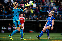Seattle, WA - Thursday, May 26, 2016: Arsenal Ladies FC goalkeeper Emma Byrne (1) grabs a ball denying Seattle Reign FC midfielder Kim Little (8). The Seattle Reign FC of the National Women's Soccer League (NWSL) and Arsenal Ladies FC of the Women's Super League (FA WSL) played to a 1-1 tie during an international friendly at Memorial Stadium.