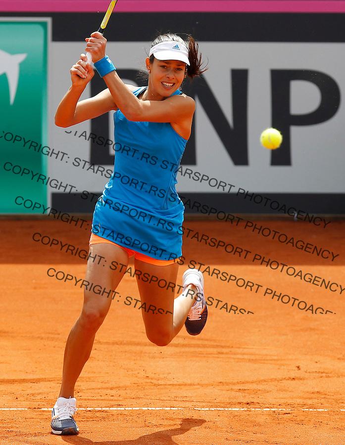 Tennis Tenis<br /> Fed Cup World Group play-off<br /> Rumunija v Srbija<br /> Sorana Cirstea v Ana Ivanovic<br /> Ana Ivanovic returns the ball<br /> Bucharest, 04.19.2014.<br /> foto: Srdjan Stevanovic/Starsportphoto &copy;