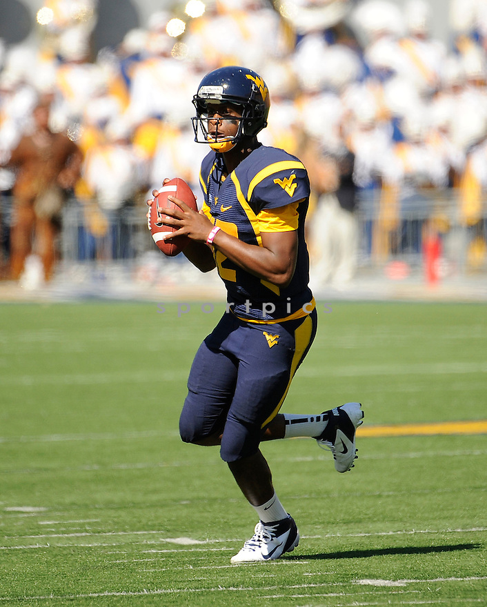 GENO SMITH, of the West Virginia Mountaineers, in action during West Virginia's game against the UConn Huskies on October 8, 2011 at Milan Puskar Stadium in Morgantown, WV. West Virginia beat UConn 43-16.