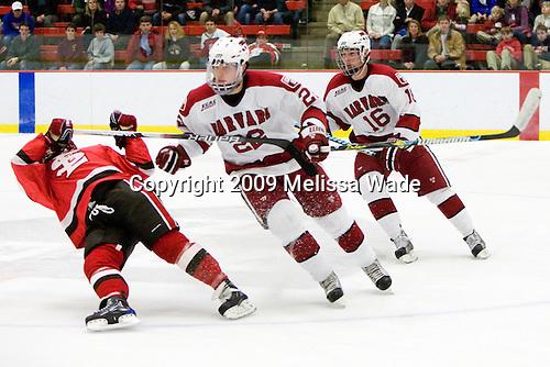 ?, David Valek (Harvard - 22), Alex Fallstrom (Harvard - 16) - The St. Lawrence University Saints defeated the Harvard University Crimson 3-2 on Friday, November 20, 2009, at the Bright Hockey Center in Cambridge, Massachusetts.