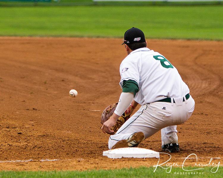 First baseman AJ Ryan (U Dayton) snags a throw for an out.
