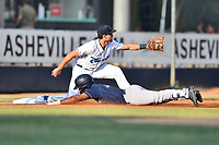 Asheville Tourists third baseman Johnny Cresto (17) fields the throw and attempts to put the tag on Josh Stowers (21) as he slides in safely during a game against the Charleston RiverDogs at McCormick Field on May 22, 2019 in Asheville, North Carolina. The Tourists defeated the RiverDogs 10-8. (Tony Farlow/Four Seam Images)