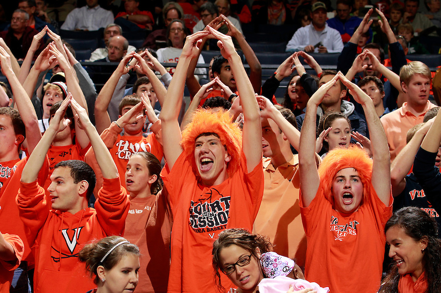 CHARLOTTESVILLE, VA- NOVEMBER 29:  Virginia Cavalier fans cheer before the game against the Virginia Cavaliers on November 29, 2011 at the John Paul Jones Arena in Charlottesville, Virginia. Virginia defeated Michigan 70-58. (Photo by Andrew Shurtleff/Getty Images) *** Local Caption ***