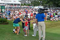 A young St. Jude patient is elated after meeting the golf pros near the green on 18 during round 4 of the WGC FedEx St. Jude Invitational, TPC Southwind, Memphis, Tennessee, USA. 7/28/2019.<br /> Picture Ken Murray / Golffile.ie<br /> <br /> All photo usage must carry mandatory copyright credit (© Golffile | Ken Murray)