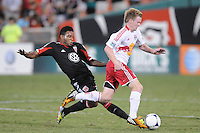 D.C. United Lionard Pajoy (26) goes against New York Red Bulls midfielder Dax McCarty (11) The New York Red Bulls tied D.C. United 2-2 at RFK Stadium, Wednesday August 29, 2012.