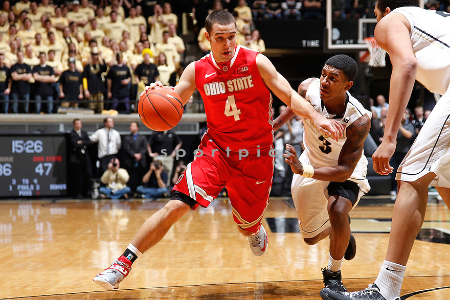 WEST LAFAYETTE, IN - JANUARY 8: Aaron Craft #4 of the Ohio State Buckeyes dribbles up the floor against Ronnie Johnson #3 of the Purdue Boilermakers during the game at Mackey Arena on January 8, 2013 in West Lafayette, Indiana. Ohio State won 74-64. Aaron Craft;Ronnie Johnson