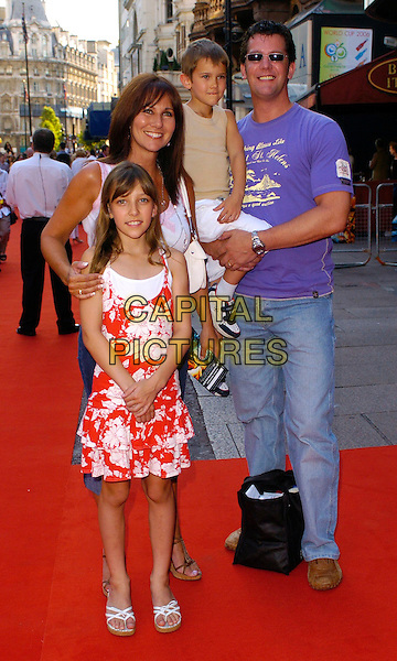 "LINDA LUSARDI & FAMILY.The ""Stormbreaker"" world premiere at Vue West End, London, UK..July 17th, 2006.Ref: CAN.full length red floral print dress kids children.www.capitalpictures.com.sales@capitalpictures.com.©Capital Pictures"