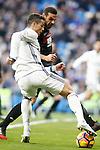 Real Madrid's Cristiano Ronaldo (l) and Granada CF's David Lomban during La Liga match. January 7,2016. (ALTERPHOTOS/Acero)