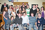 TRIPLE: A large crowd turned up at the triple 21st birthday celebrations for Brian Sugrue, Michael Leen and Aidan OConnell (seated front), all from Ballymac, in ORiadas Bar, Ballymac, last Friday night..