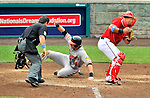 19 June 2011: Baltimore Orioles' outfielder Nolan Reimold slides home safely in the 8th inning against the Washington Nationals on Father's Day at Nationals Park in Washington, District of Columbia. The Orioles defeated the Nationals 7-4 in inter-league play, ending Washington's 8-game winning streak. Mandatory Credit: Ed Wolfstein Photo