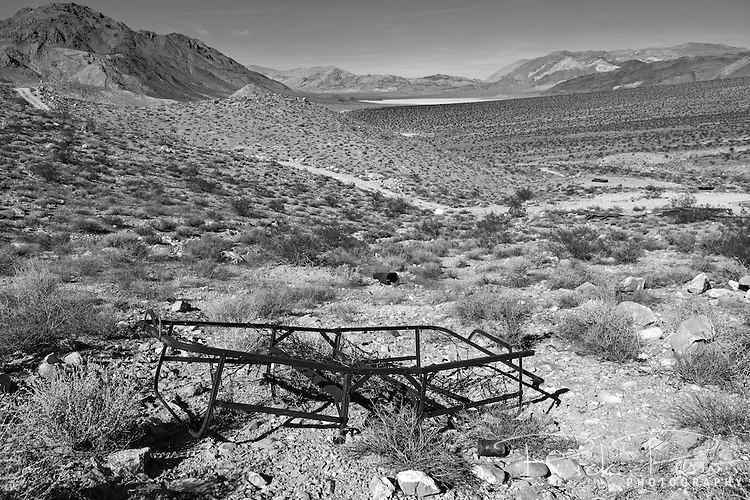 Rusted bed frame lies on the hillside at the Lippincott Mine near the Racetrack Playa in Death Valley National Park.