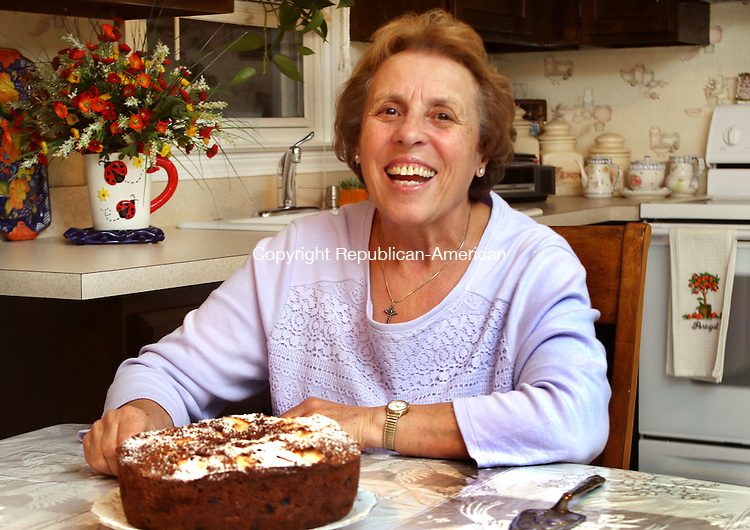 PROSPECT CT. 21 November 2016-112116SV04-Maria Silva sits at a table in her kitchen in Prospect Monday. Silva will appear in Food TV&rsquo;s &lsquo;Clash of the Grandmas&rsquo; which airs December 4th.<br /> Steven Valenti Republican-American