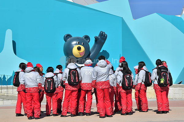 Helpers walking by the Olympic mascot, the Asian black bear Bandabi, in Gangneung, South Korea, 07 February 2018. The Pyeongchang 2018 Winter Olympics take place between 09 and 25 February. Photo: Peter Kneffel/dpa /MediaPunch ***FOR USA ONLY***