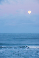 Moon setting over the Pacific Ocean