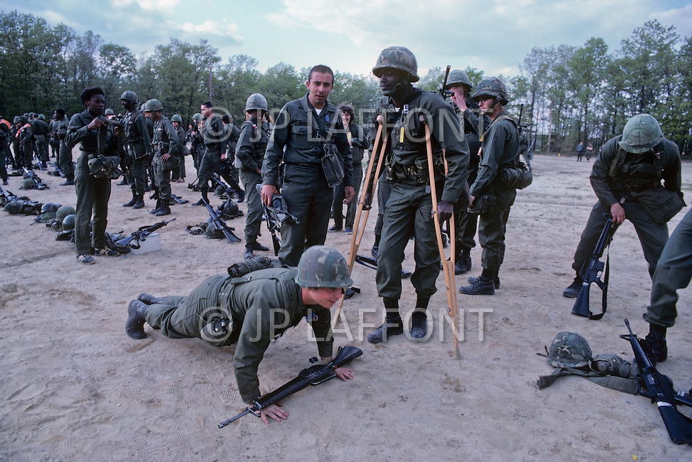Fort Dix, NJ, USA, June 1980. US Army military training. Work outs are very intense, especially in the first weeks and corporal punishments are not uncommon.