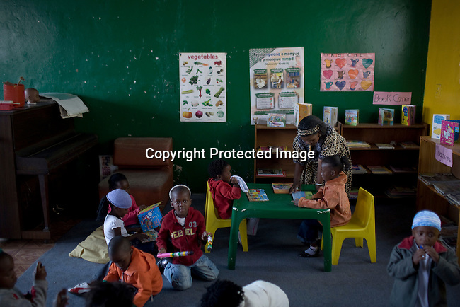 ALEXANDRA, SOUTH AFRICA - SEPTEMBER 2: Children play at Hlayisanani Pre-School on September 2, 2008 in Alexandra, outside Johannesburg, South Africa. Mischa Barton spent 2 days visiting Save The Children supported projects in South Africa, meeting school children and young children. Save The Children are helping about 51,000 children made by HIV/AIDS and poverty to access food, healthcare, social security and education. (Photo by Per-Anders Pettersson/Getty Images For Save The Children).