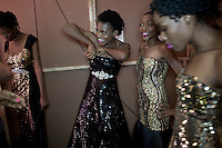 HARARE, ZIMBABWE - SEPTEMBER 26: Models wait backstage before a fashion show on September 26, 2014 at the Harare City library in Harare, Zimbabwe. Local and African and based designers showed their collections during the 5th edition of Zimbabwe Fashion week (Photo by: Per-Anders Pettersson)
