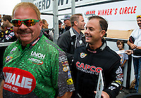 Aug 17, 2014; Brainerd, MN, USA; NHRA top fuel dragster driver Steve Torrence (right) with Terry McMillen during the Lucas Oil Nationals at Brainerd International Raceway. Mandatory Credit: Mark J. Rebilas-