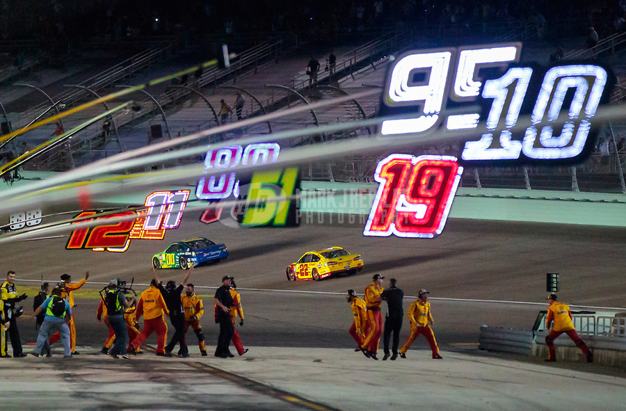 Nov 18, 2018; Homestead, FL, USA; Crew members for NASCAR Cup Series driver Joey Logano (22) celebrate winning the Ford EcoBoost 400 and the NASCAR Cup Series championship at Homestead-Miami Speedway. Mandatory Credit: Mark J. Rebilas-USA TODAY Sports