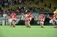 BOGOTA - COLOMBIA -29 -11-2014: Bastoneras de Independiente Santa Fe, animan a su equipo durante partido entre Independiente Santa Fe y Atletico Huila por la fecha 4 de los cuadrangulares semifinales de la Liga Postobon II-2014, en el estadio Nemesio Camacho El Campin de la ciudad de Bogota.  / Cheerleaders of Independiente Santa Fe cheer for their team during a match between Independiente Santa Fe and Atletico Huila by the fourth date of the quadrangular semifinals of the Liga Postobon II -2014 at the Nemesio Camacho El Campin Stadium in Bogota city, Photo: VizzorImage  / Luis Ramirez / Staff.