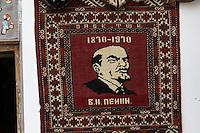 Uzbekistan, Bukhara. Abdul Aziz Khan Medressa. Souvenir shops in students' cells. Lenin rug.