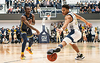 WASHINGTON, DC - FEBRUARY 22: Jameer Nelson Jr. #12 of George Washington tries to stop  pass from David Betty #1 of La Salle during a game between La Salle and George Washington at Charles E Smith Center on February 22, 2020 in Washington, DC.