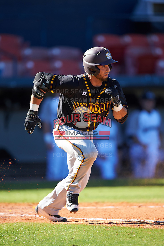 Bethune-Cookman Wildcats catcher Michael Cruz (15) runs to first during a game against the Wisconsin-Milwaukee Panthers on February 26, 2016 at Chain of Lakes Stadium in Winter Haven, Florida.  Wisconsin-Milwaukee defeated Bethune-Cookman 11-0.  (Mike Janes/Four Seam Images)