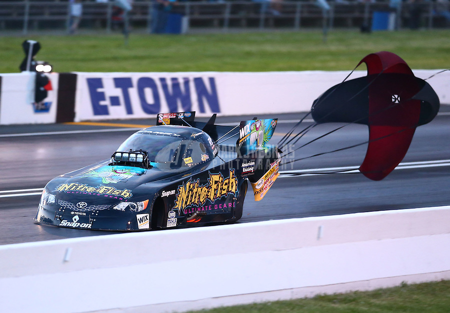 May 30, 2014; Englishtown, NJ, USA; NHRA funny car driver Tony Pedregon during qualifying for the Summernationals at Raceway Park. Mandatory Credit: Mark J. Rebilas-