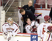 Brian Billett (BC - 1), John Hegarty (BC - Dir-Hockey Ops), Bert Lenz (BC - Trainer), Johnny Gaudreau (BC - 13) - The Boston College Eagles defeated the University of Massachusetts-Amherst Minutemen 3-2 to take their Hockey East Quarterfinal matchup in two games on Saturday, March 10, 2012, at Kelley Rink in Conte Forum in Chestnut Hill, Massachusetts.