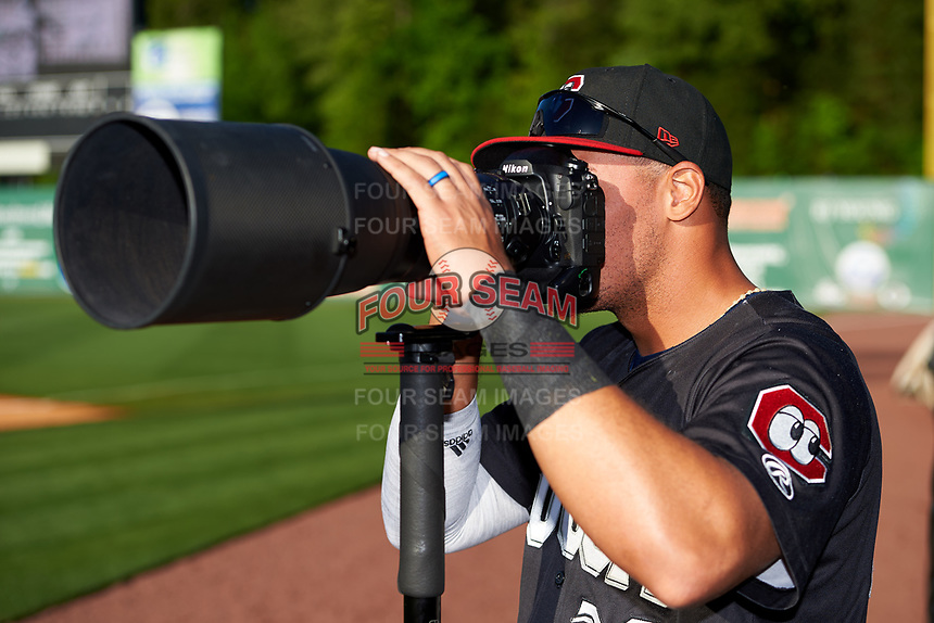 Chattanooga Lookouts Jonathan Rodriguez (30) tries his hand as a photographer before a game against the Jackson Generals on April 27, 2017 at The Ballpark at Jackson in Jackson, Tennessee.  Chattanooga defeated Jackson 5-4.  (Mike Janes/Four Seam Images)