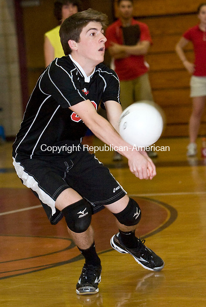 CHESHIRE, CT - 22 APRIL 2009 -042209JT02-<br /> Cheshire's John Shea bumps the ball during Wednesday's match against Newington at Cheshire.<br /> Josalee Thrift Republican-American