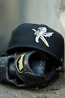 A Charlotte Knights cap sits on top of a glove in the home dugout during the game against the Buffalo Bisons at BB&T Ballpark on May 9, 2014 in Charlotte, North Carolina.  The Knights defeated the Bisons 5-3.  (Brian Westerholt/Four Seam Images)