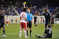 Referee Andrew Chapin issues a yellow card to Mehdi Ballouchy (10) of the New York Red Bulls. The New York Red Bulls defeated Sporting Kansas City 1-0 during a Major League Soccer (MLS) match at Red Bull Arena in Harrison, NJ, on April 30, 2011.