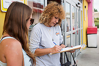 Alli Tolbert (cq, left) registers Leticia Martinez (cq) to vote at a Lowes Mercado grocery store, in Denver, Colorado, Thursday, August 23, 2012. Colorado is a state up for grabs in the election, and Latino voters will likely play a part in who wins the state...Photo by MATT NAGER