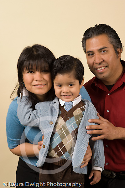 portrait of 3 year old boy with his parents mother and father vertical